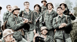 THE DIRTY DOZEN, crouching and seated from front left: Telly Savalas, Donald Sutherland, John Cassavetes; standing from left: Clint Walker, Al Mancini, Jim Brown, Stuart Cooper, Trini Lopez (helmet), Ben Carruthers (top), Tom Busby, Colin Maitland, Charles Bronson, 1967